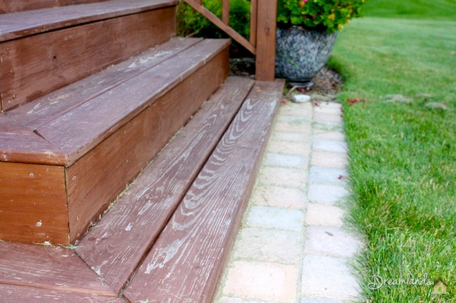 The deck stairs, one of the high traffic areas, but not the only location where the stain is peeling