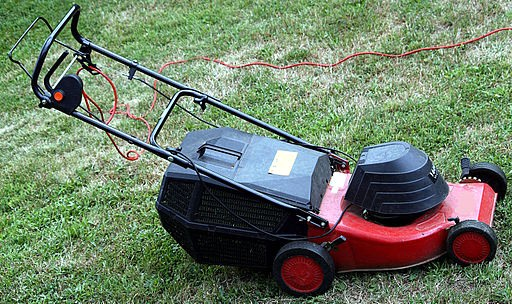 Electric lawn mower plugged in (How to Mow a Lawn Fast and Professionally)