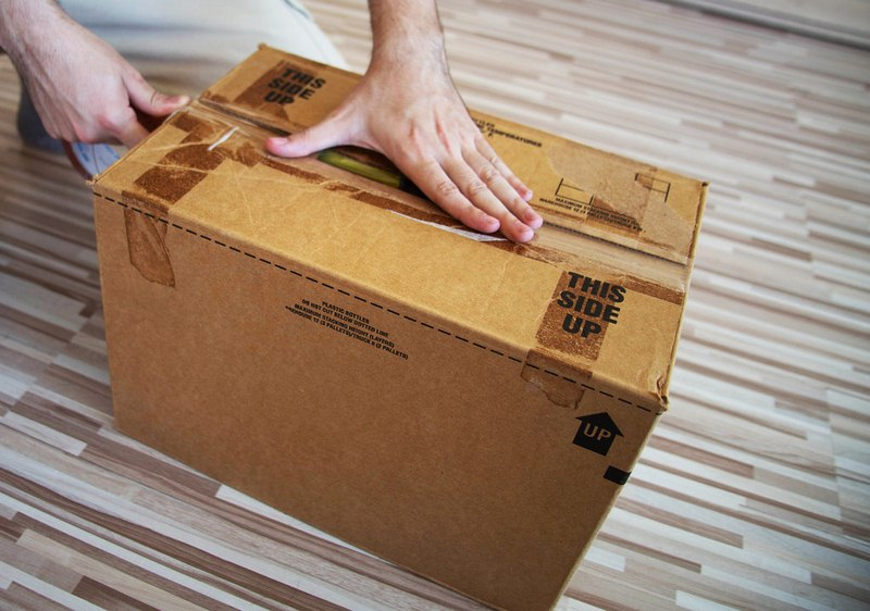 A taped and labelled moving box - Pack Like a Pro with This Moving Packing Guide