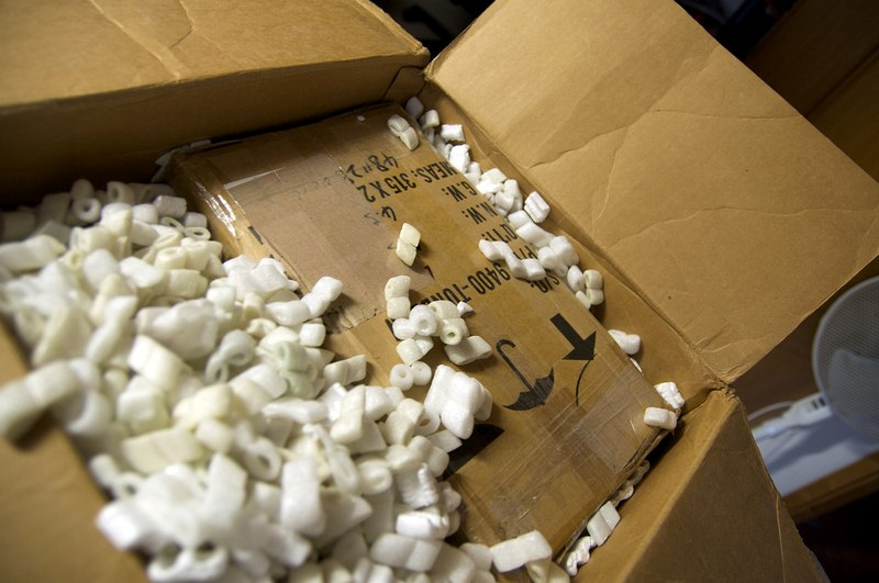 A packed item secured with packing peanuts - Pack Like a Pro with This Moving Packing Guide
