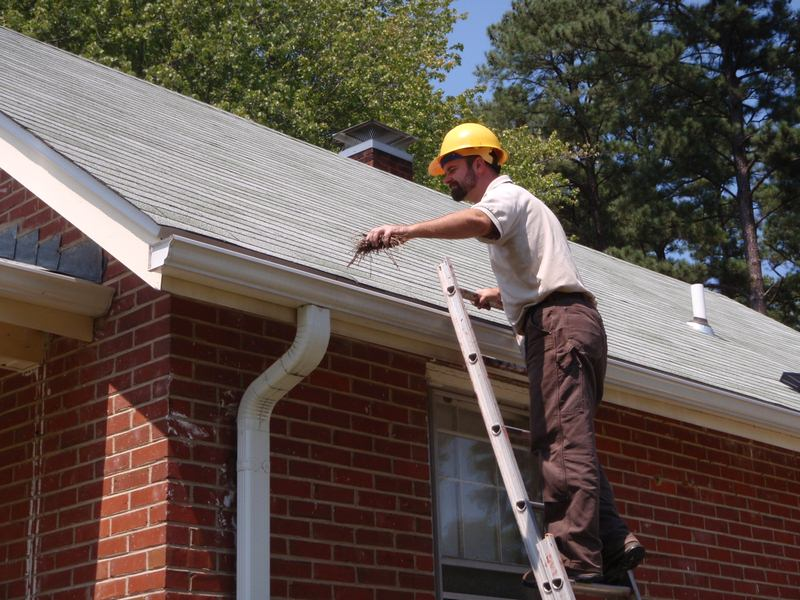 Unclogging Gutters - Common Home Maintenance Mistakes You May Be Making