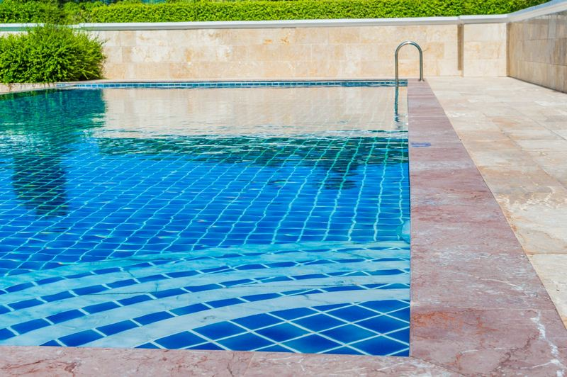 Waterline Tile - 7 Renovation Ideas to Make Your Swimming Pool Awesome