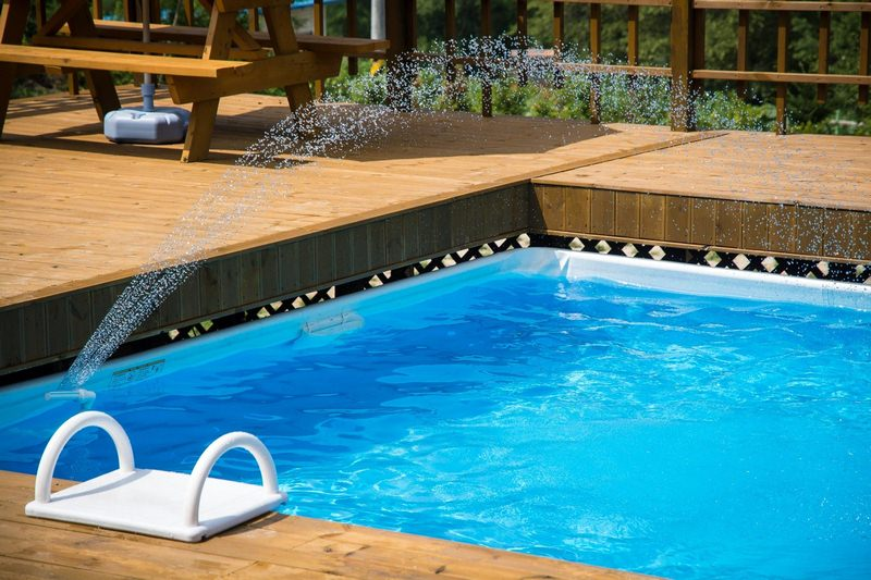 A Pool with Extra Water Features - 7 Renovation Ideas to Make Your Swimming Pool Awesome