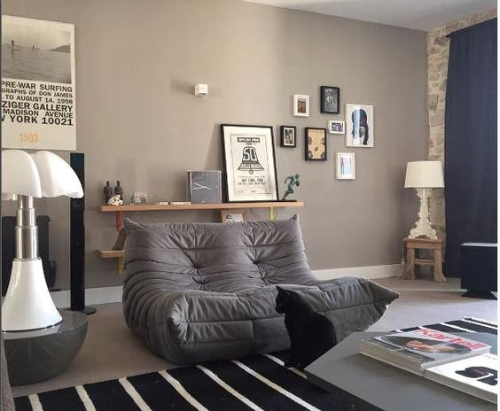 Shelves in the Background - How to Accessorize Around Your Togo Sofa