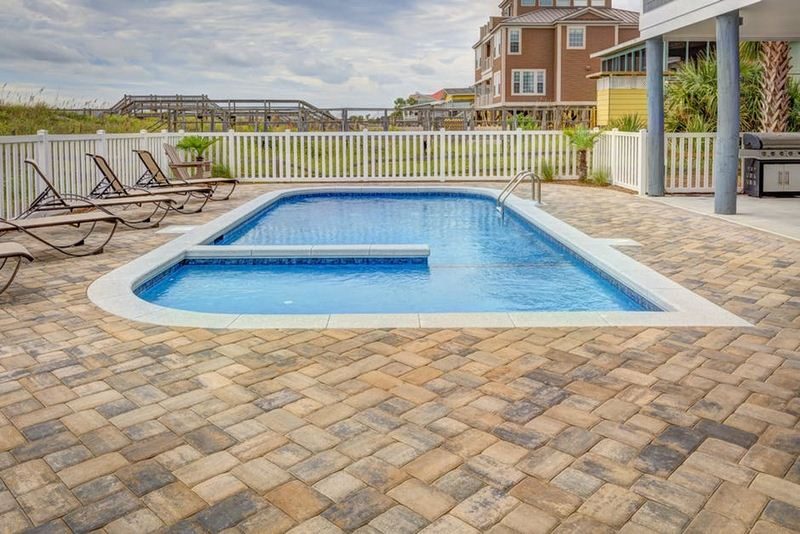 Fiberglass vs Concrete Pools - A Pros & Cons Breakdown for Your Backyard