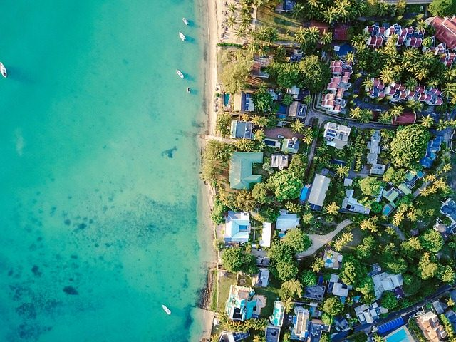 image - An aerial view of a coastline with houses, representing coastal home decor ideas