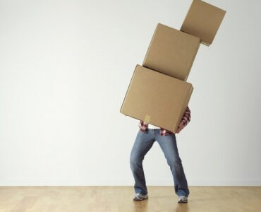 Featured image - DIY vs. Professional Movers - Pros and Cons