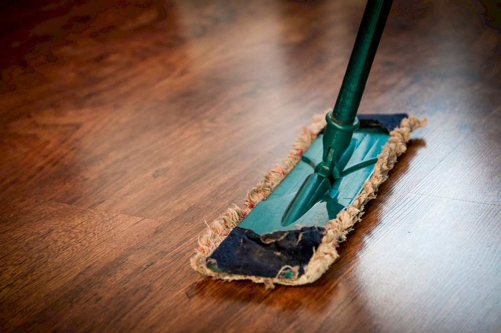 image - A mop representing cleaning your home which is one of the best maintenance tips for your Florida home.