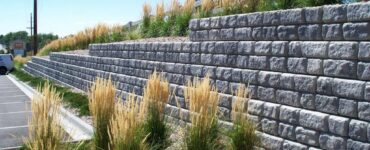 Featured image - The 4 Benefits to Adding a Retaining Wall to Your Landscape