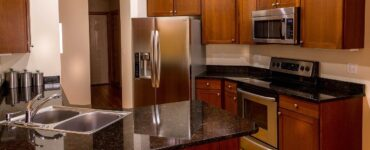 featured image - Just Like New 3 Tips for Repainting Kitchen Cabinets