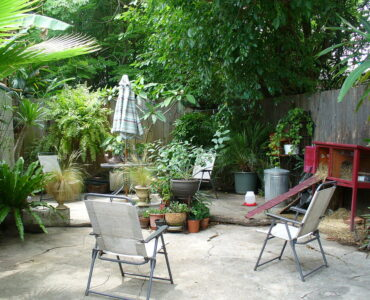 featured image - 8 Gorgeous Backyard Concrete Patio Ideas You Need to Try