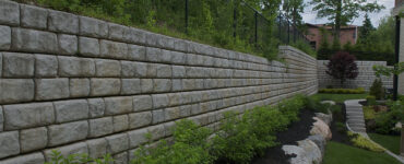 featured image - Benefits of Hiring a Retaining Wall Contractor