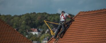 featured image - To Repair or Replace? A Guide on When Roof Replacement is Necessary