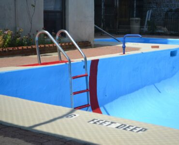featured image - How to Fit a Ladder to Your Above-Ground Pool—The Right Way