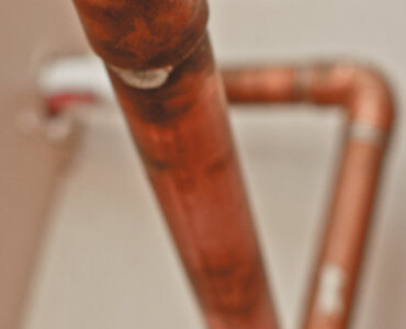 featured image - What You Should Know About Pinhole Leak in Copper Pipe