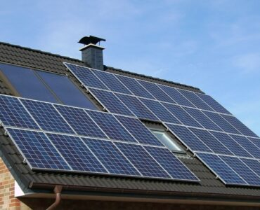 featured image - How Much Does It Cost to Buy Solar Panels for Your Home