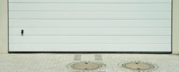 fetaured image - Is a Damaged Garage Door Covered by Insurance?